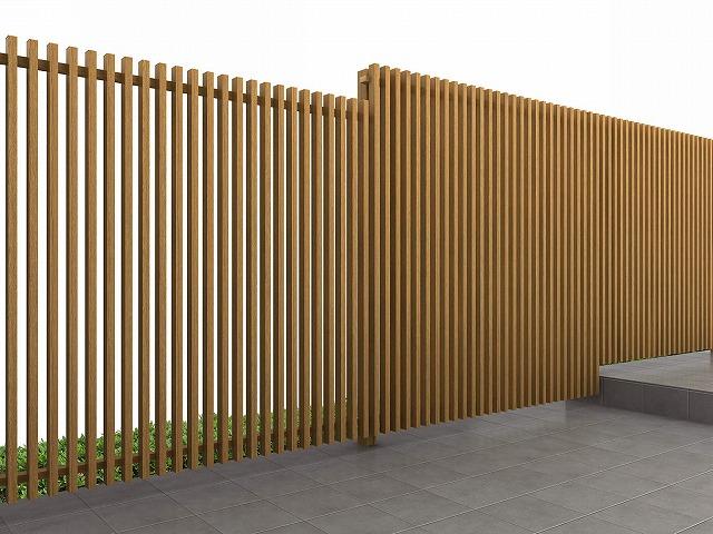 ↑ルシアス スクリーンフェンス S02型 たて格子 段差施工 左:T180中央:T200右:T180 W7__XFW70400